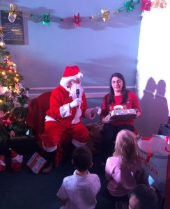 Father Christmas handing out presents to foster children in Walsall